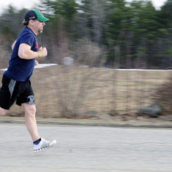 Jeff Ross trains for the Boston Marathon on Thursday in China. Ross will be running the Boston Marathon on Monday.