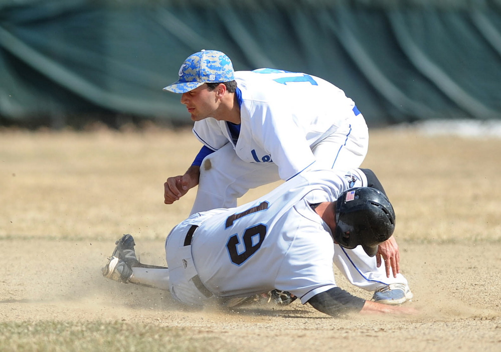 Colby College shortstop Tommy Forese (14) tags out Tufts University's Matt Moser (19) at second base in the second inning Friday at Colby College in Waterville.