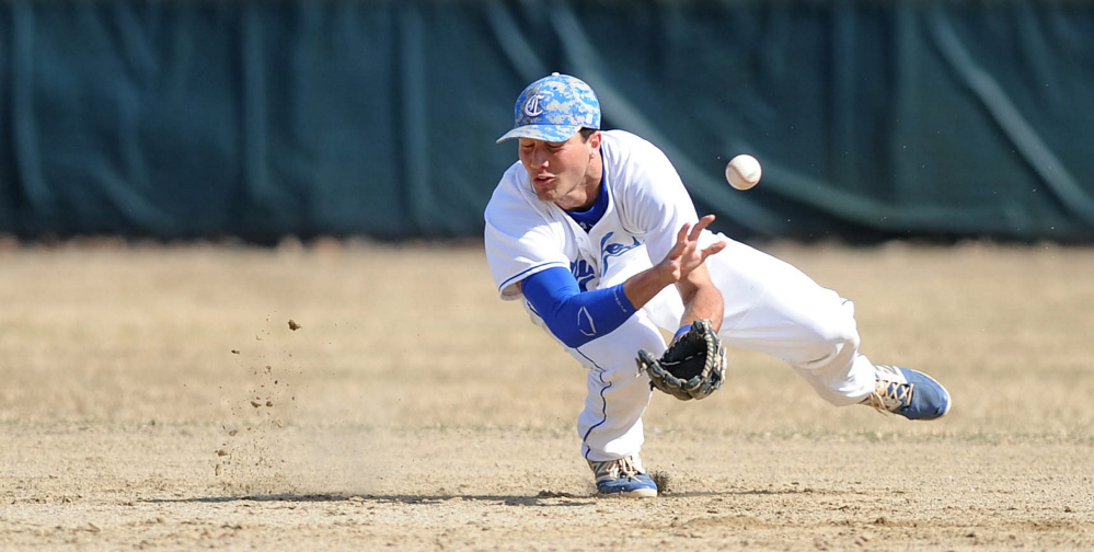 Colby College shortstop Tommy Forese (14) misses the ground ball in the first inning against Tufts University on Friday at Colby College in Waterville.