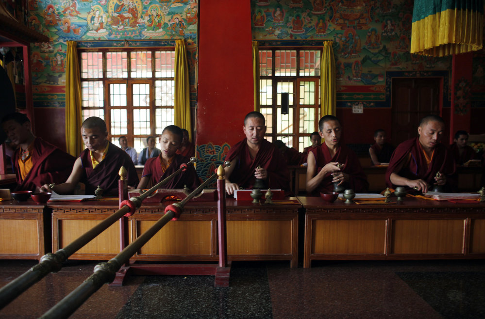 Buddhist Monks perform one-year death anniversary rituals for Ang Kaji Sherpa, a victim of last year's deadly avalanche in Everest, at a monastery in Kathmandu, Nepal, on Saturday.