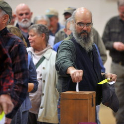 New Sharon residents cast ballots for a new selectman during a special town meeting at the Cape Cod Hill School on Saturday.