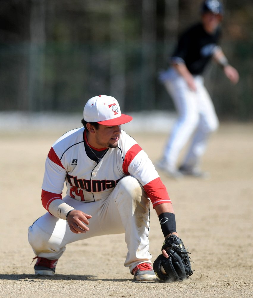 Thomas College third baseman Michael De Los Santos fields a ground ball in the fifth inning Saturday against Colby-Sawyer at Thomas College in Waterville.