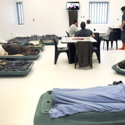 Inmates watch television in April in an overcrowded pod at the Kennebec County Correctional Facility in Augusta. Men incarcerated at the facility often sleep on the floor because of a lack of space.