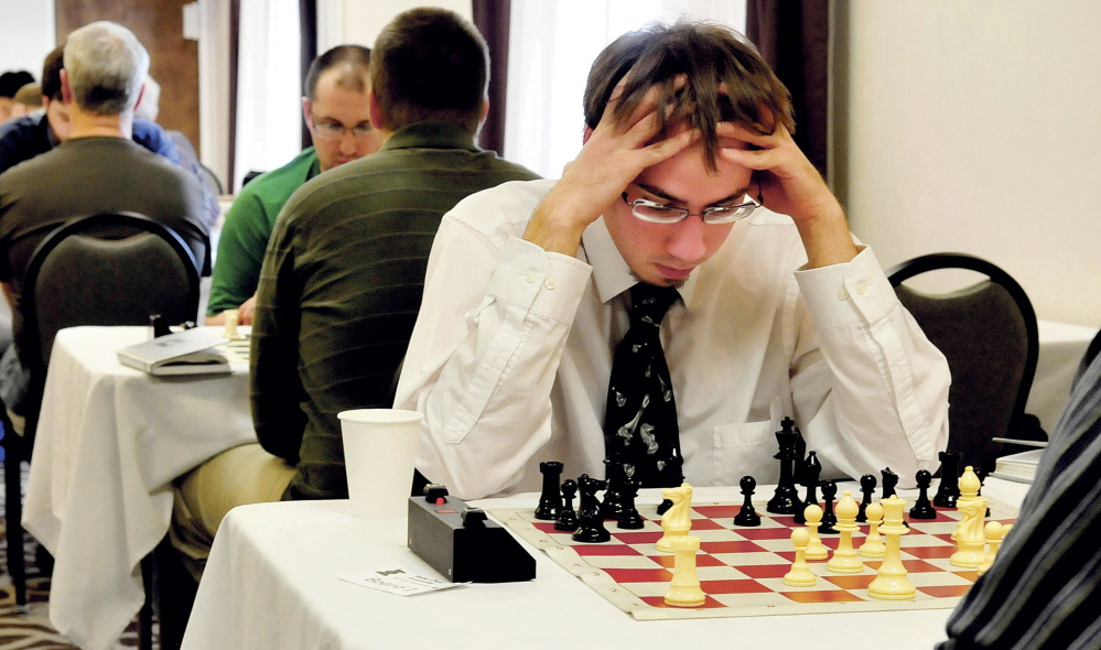 Chess player Aaron Spencer thinks about his next move against winner Jarod Bryan during Maine Closed Chess Championship in Waterville on Sunday.