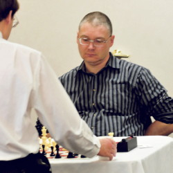 Maine Closed Chess Championship winner Jarod Bryan plays against Aaron Spencer on Sunday.