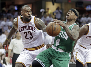 AP photo Boston's Isaiah Thomas (4) loses the ball after a foul by Cleveland's LeBron James (23) in the second quarter of a first-round playoff game Sunday in Cleveland.