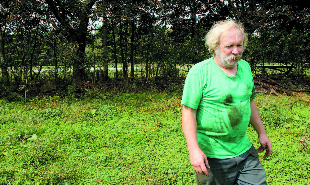 Farmer Mark Gould, seen in this 2011 photo, owns farm property that abuts Interstate 95 in Sidney. He is facing complaints that he's not properly disposing of dead animals on his property.