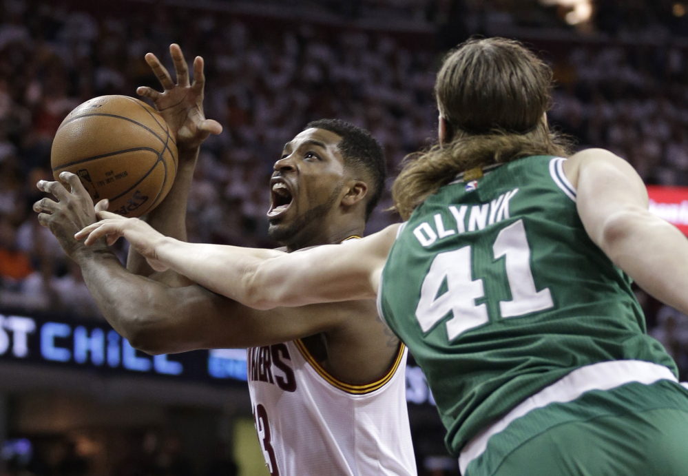 """Cleveland Cavaliers' Tristan Thompson (13) drives to the basket against Boston Celtics' Kelly Olynyk (41) during the first round of the NBA playoffs Sunday in Cleveland. The """"Big 3"""" garner all the hype and headlines, but the Cavaliers are much more than LeBron James, Kyrie Irving and Kevin Love. Cleveland's bench came through in Game 1 against Boston as reserves Thompson and James Jones made huge contributions in the 113-100 win."""
