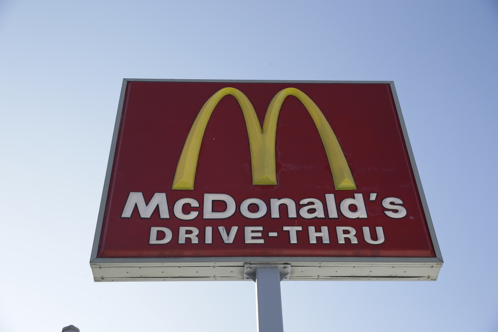 This Thursday, Jan. 15, 2015, file photo, shows a McDonald's fast food restaurant sign in Chicago.