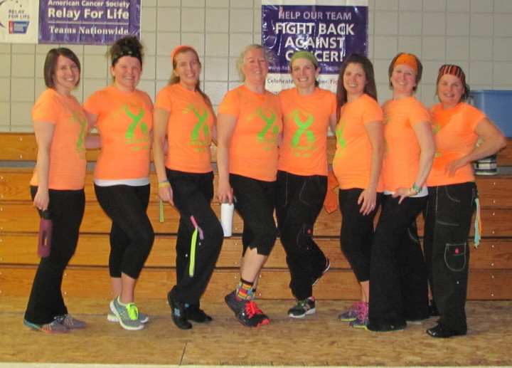 CAP.cutline_standalone:Zumba Strong No One Fights Alone was held April 3 at Madison Area High School to benefit the American Cancer Society — Somerset County Relay For Life. More than $1,200 was raised. There were 75 who participated for two hours. From left, are Allison Marcoux, Tamara Tardiff, Susan Lamb, Denise Delorie, Melody Rich, Hillary White, Tiara Nile (organizer) and Monica Gilbert Beach. Footprints and cupcakes were also sold and put on the wall with the names of heroes of those who passed, survived or currently fighting cancer.