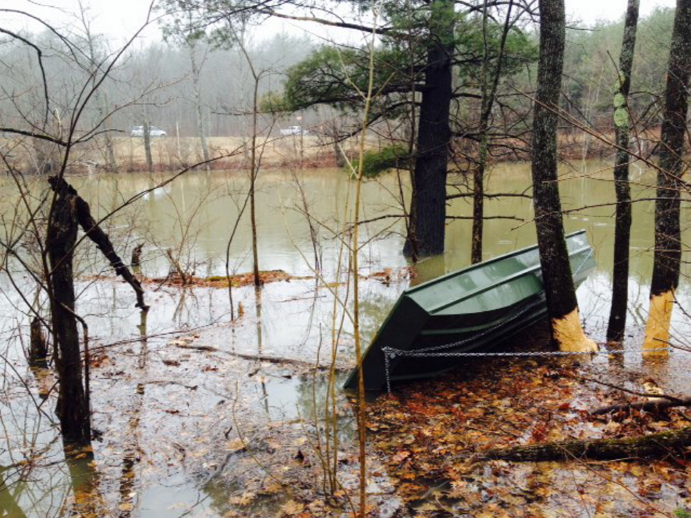 A boat that had been tied to a tree on the banks of Messalonskee Stream in Waterville appeared to have capsized, prompting an emergency response Tuesday in Waterville.