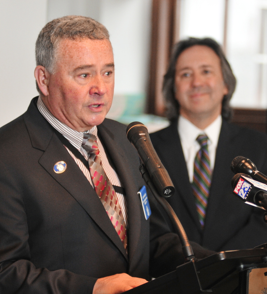 Rep. Gary L. Hilliard, R-Belgrade, left, speaks on Tuesday as Rep. Drew Gattine, D-Westbrook, watches at a State House news conference about an arsenic bill they are sponsoring.