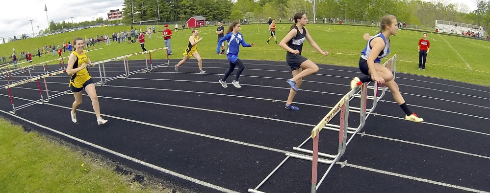 Erskine Academy hurdler Micheala Sprague leads her heat in the 100-meter hurdles during the Capital City Classic at Cony High's Alumni Field in Augusta last May. The Elsie and William Viles Foundation is donating $250,000 to improve Alumni Field.