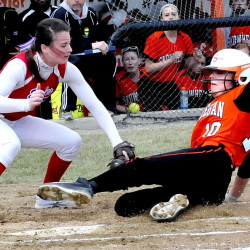 Messalonskee pitcher Kirsten Pelletier, left, covers home plate as Skowhegan's Eliza Bedard makes it safe during a game on Wednesday.