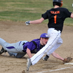 Waterville first baseman Ben Cox, left, dives to tag the base and force out of Jake Trask in the second inning of a season opener Wednesday in Waterville. The Raiders pulled out a 10-9 victory.