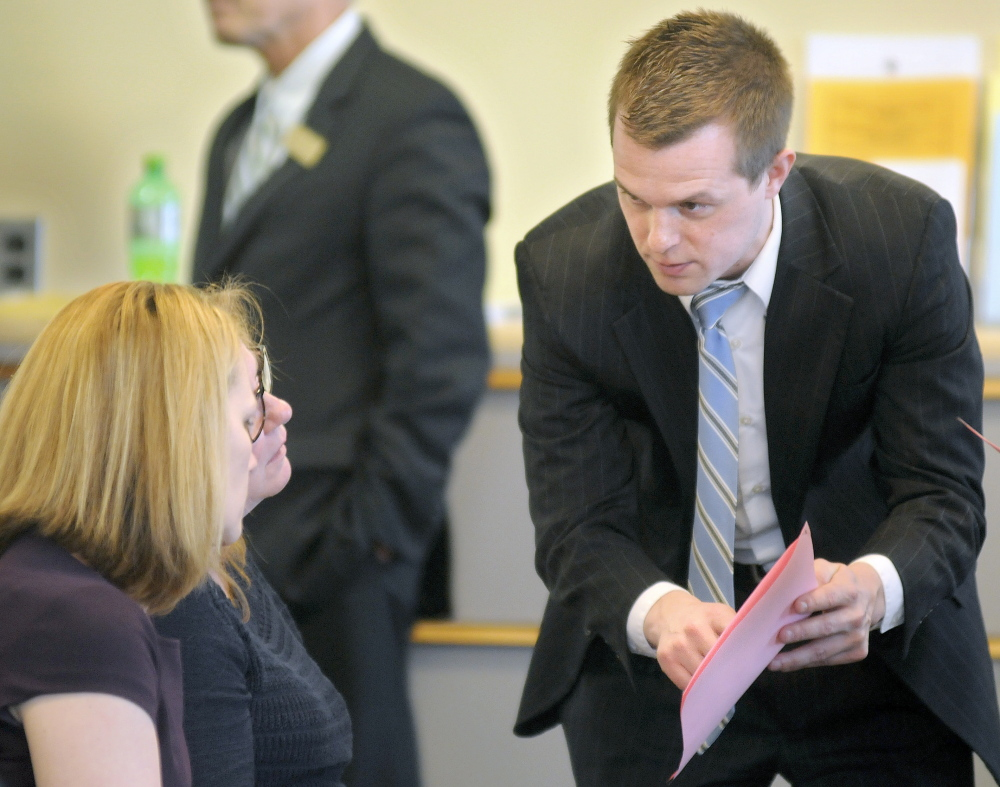 Volunteers of America vice presidents Melissa Morrill, left, and Julia Wilcock speak on Thursday with Rep. Jared Golden, D-Lewiston, about legislation he sponsored to help build housing for homeless veterans at the VA Maine Healthcare Systems-Togus. Volunteers of America is a charity that is a major supporter of Golden's initiative. The group met before a work session at the State House.