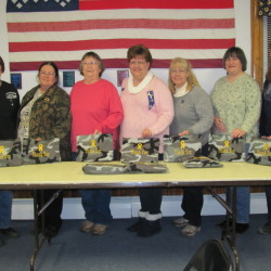 Madison American Legion Auxiliary recently prepared and sent thank-you care packages to active duty American Legion members. Auxiliary members who participated included, from left, Harriet Bryant, Kathleen Randall, Lauraine Mercier, Robin Turek, Sandy Ingalls, Tena Ireland and Pat Santoni. Each gift was put in a camouflage zippered bag with the words Thank You embroidered on it. The 31 bags were purchased through American Legion Auxiliary member Sharelyn Parker. They were filled with items such as toiletries and fun stuff. The packages were mailed to the 10 members of the American Legion Post 39, Madison, who are on active duty in the military (stateside and abroad), according to a news release from the auxiliary. For more information about the auxiliary, visit ALAforVeterans.org or mainelegionpost39.org.