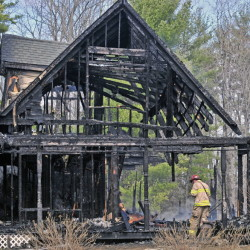 Firefighters from several communities responded to a fire that destroyed a home Friday at 131 Hunter Road in Dresden.