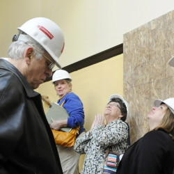 Members of Cony High School's class of 1958 tour the flatiron building, which once housed the high school, in Augusta on Wednesday. It's being renovated for senior housing.