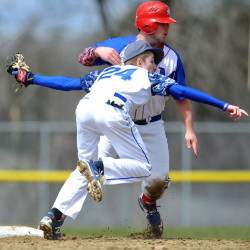 Messalonskee High School's Connor Garland (14) slides safely in to second base on the steal under the tag of Lawrence High School's Evan Grard (24) in the third inning Friday at Lawrence High School in Fairfield.