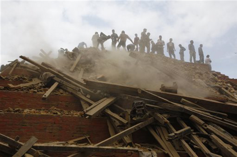 Volunteers help remove debris of a building that collapsed at Durbar Square, after an earthquake in Kathmandu, Nepal, on Saturday.