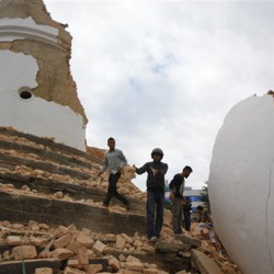 Volunteers work to remove debris at the historic Dharahara tower, a city landmark, after an earthquake in Kathmandu, Nepal, on Saturday.