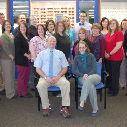 Dr. Richard Smart, front with Dr. Lesley Sobeck, poses with the staff of the Augusta Smart Eye Care Center. Smart and his company are celebrating 25 years with an open house at the Western Avenue center Friday.