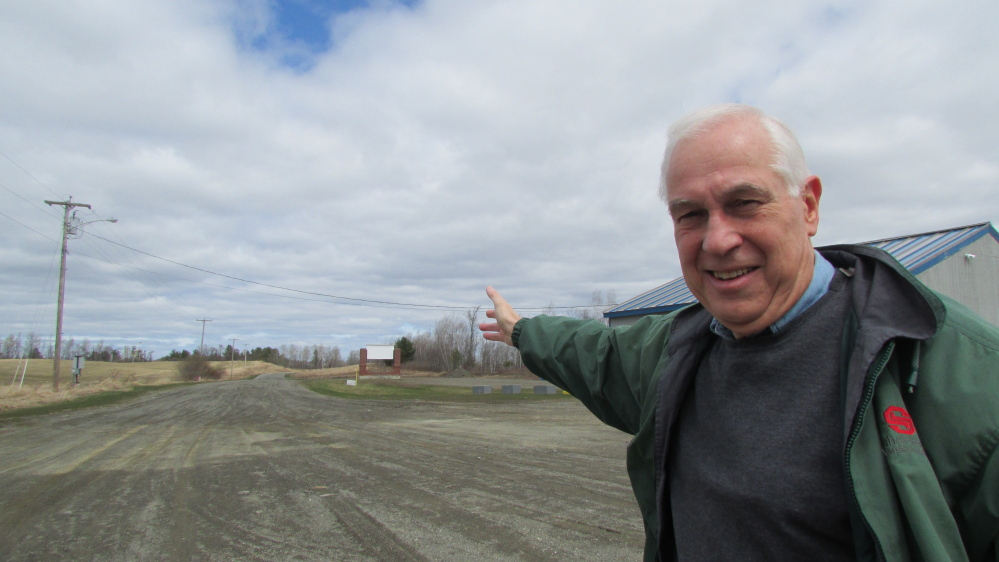 Doug Cutchin points to land open for development along Industrial Drive in Fairfield. Cutchin is moving forward with a plan to donate land to the town to extend the road to the Waterville city line and hopes to connect it to Industrial Street in Waterville.
