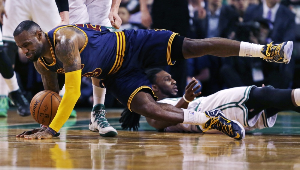 Cleveland Cavaliers forward LeBron James hits the floor after colliding with Boston Celtics forward Jae Crowder during the second quarter Thursday in Boston. The Celtics are one loss away from playoff elimination.