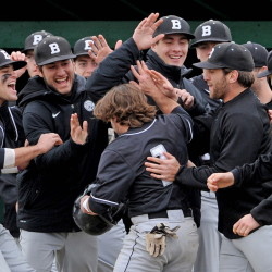 Bowdoin College celebrates with teammate Chris Cameron, 1, after scoring against Colby College on Saturday in Waterville.