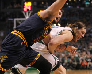 AP photo Cleveland Cavaliers forward Kevin Love, left, is dragged by the arm by Boston Celtics center Kelly Olynyk during the first quarter of a first-round playoff game Sunday in Boston. The play resulted in an injury to Love that forced him from the game.