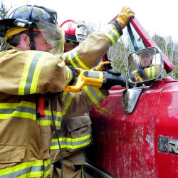 Richmond firefighter Douglas Rioux uses tools that can sever off parts of a vehicle during an extrication training session in Oakland on Sunday.