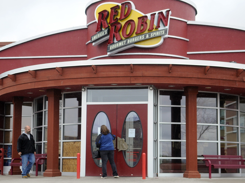 Diners are turned away Monday from the Red Robin in Augusta after a fire damaged the kitchen Sunday night.
