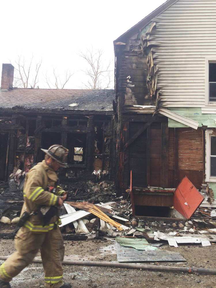 A mother and her two young children safely escaped a fire Sunday that destroyed a portion of an Old Cedar Grove Road home in Pittston.