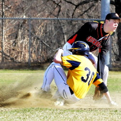 Skowhegan's Garret McSweeney attempts to tag out Mt. Blue runner Ethan Andrews during a Kennebec Valley Athletic Conference Class A game Monday afternoon in Farmington. Mt. Blue won 11-1.