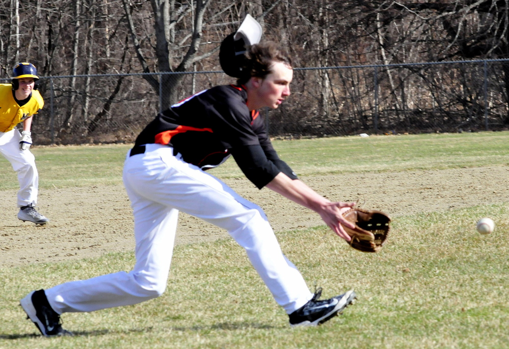 Skowhegan's Mike Berry loses his hat attempting to grab a line drive during a Kennebec Valley Athletic Conference Class A game Monday in Farmington.