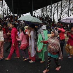 Nepalese victims of an earthquake stand in a queue to receive food in Kathmandu, Tuesday.
