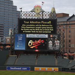 The scoreboard announces that the baseball game between the Baltimore Orioles and the Chicago White Sox is postponed, at Oriole Park at Camden Yards, Monday, in Baltimore.