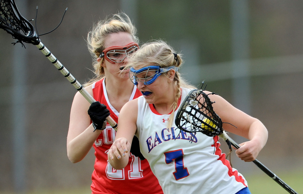 Cony's Christina Claudel (21) defends against Messalonskee's Lydia Dexter (7) on Tuesday in Oakland.