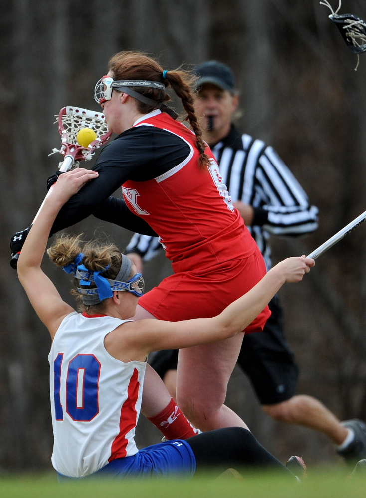 Cony's Mary Kirschner (6) collides with Messalonskee's Riley Field (10) on Tuesday in Oakland.