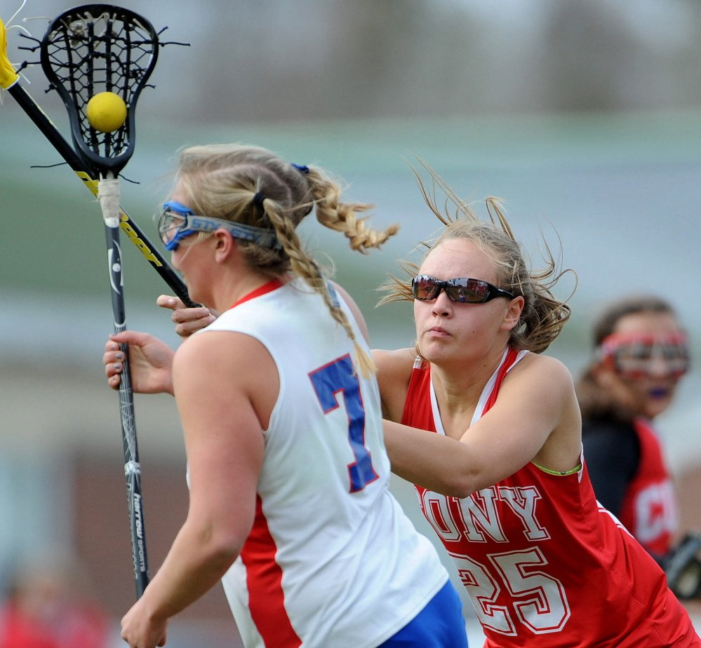Cony's Samantha Akers (25) defends against Messalonskee's Lydia Dexter (7) in the second period Tuesday in Oakland.