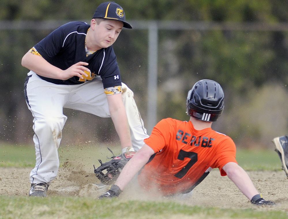 Gardiner's Nic Berube is tagged at second base by Marancook's Matt Gyorgy on Tuesday in Gardiner.