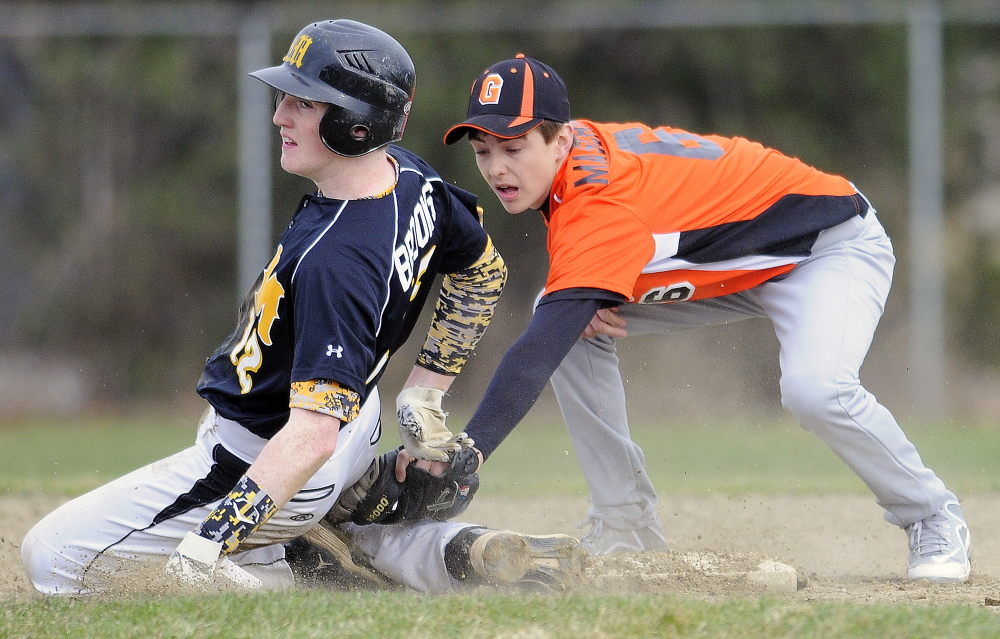 Gardiner's Devon Maschino tags Maranacook's Jason Brooks at second base Tuesday in Gardiner. The throw came in late and Brooks made it safely to base.