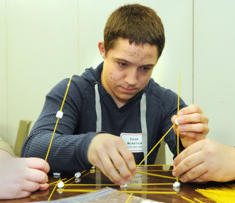Caleb McArthur and his Richmond High School teammates build a tower from marshmallows and spaghetti during the group activity contest during the Jobs for Maine's Graduates event on Wednesday at the Augusta Civic Center.