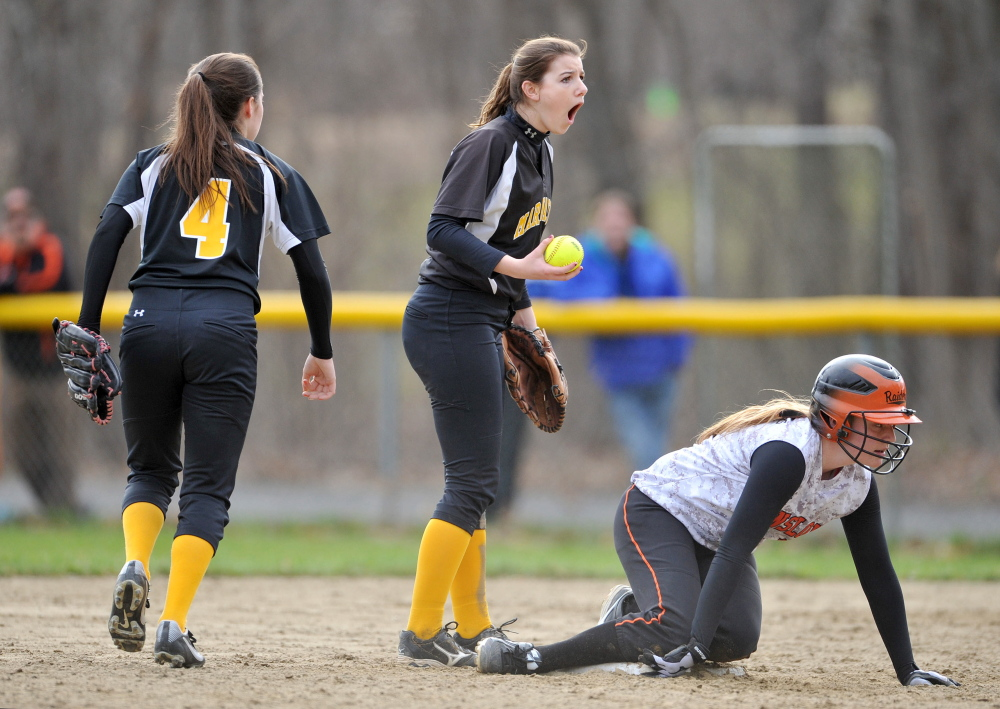 Maranacook shortstop Elise Linton, center, reacts after Winslow's Kelsey Houston, right, is called safe on a steal of second base Wednesday.