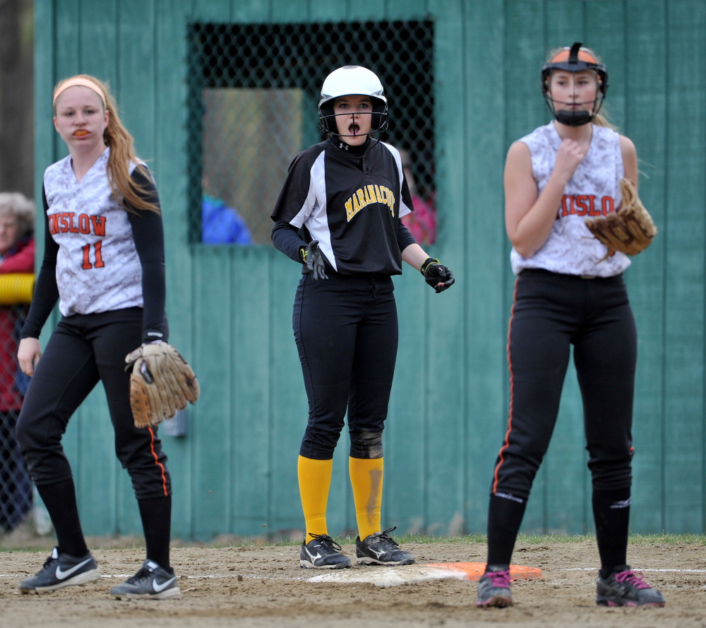 Maranacook's Elise Linton, middle, reacts after being called out at first base as Winslow's Kelsey Houston (11) and Nat Greene (8) return to their positions during a game in Winslow on Wednesday.