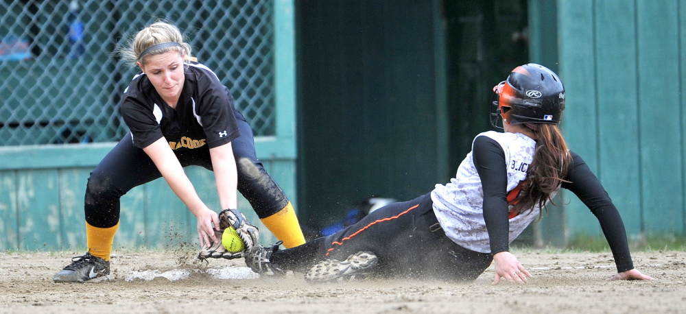 Maranacook's Leah Poulet (23) fields a throw at third base and tries to tag out Winslow runner Brooke Haskell during a game Wednesday.
