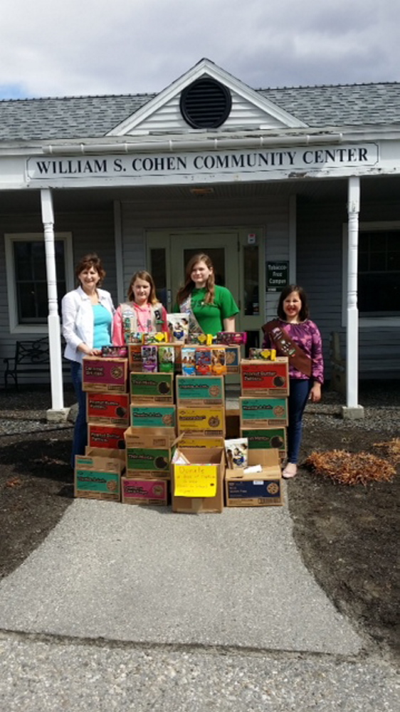 """The Cobbossee Service Unit 626 Girls Scouts donated 224 boxes of Girl Scout cookies April 17 to Spectrum Generations Cohen Community Center's Nutrition Program. """"The Scouts wanted to do something for our seniors, so the girls decided to 'gift' cookies to our homebound neighbors as a special treat,"""" Sandy Moody, Troop leader, said in a news release from the center. From left, are, Lynda Johnson, nutrition coordinator, and Girl Scouts Brailey Burden, Shelby Berlew and Georgiana Davis."""