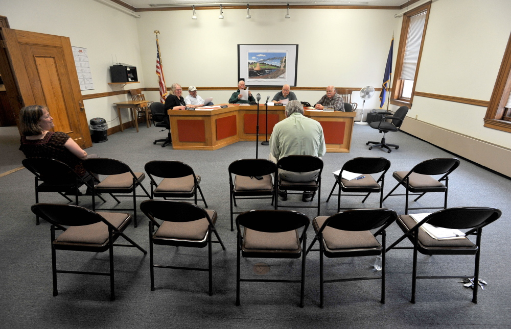 The Skowhegan Board of Assessors meets to finalize and formalize the vote by the board to deny a requested tax abatement for the Sappi paper mill at the Skowhegan Municipal Building on Thursday.