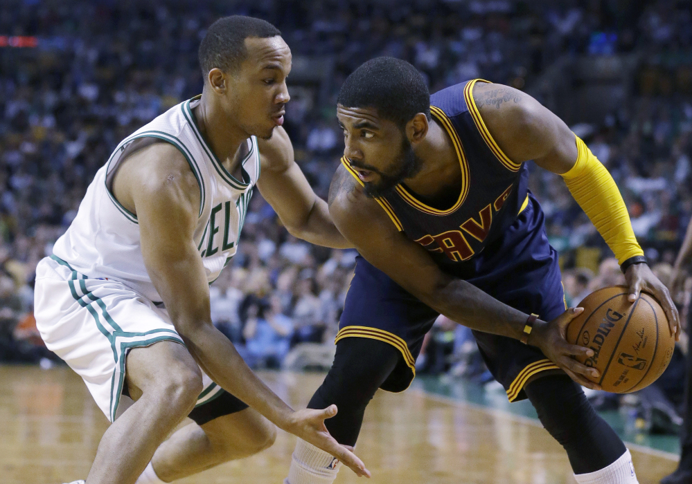 Boston Celtics guard Avery Bradley, left, tries to keep pressure on Cleveland Cavaliers guard Kyrie Irving, right, who looks for an opening in the third quarter last week in Boston. Bradley was just one of the bright spots on a Celtics roster that looks to build through the draft and free agency during the offseason.